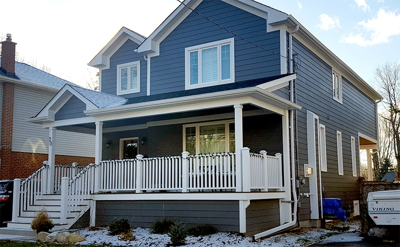 Bungalow to two story with cantilever a m pro builders inc for Two storey bungalow